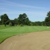 A view of a green protected by sand trap at Fox Valley Golf Club