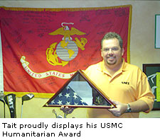 Tait proudly displays his USMC Humanitarian Award